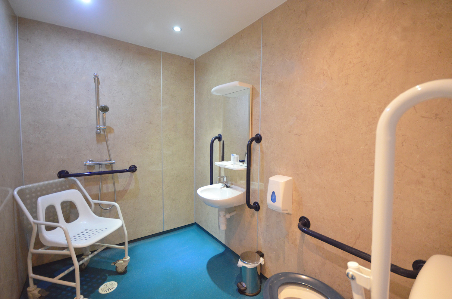 Bathroom with plenty of mobility equipment